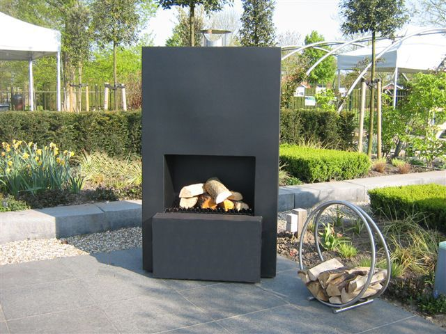 De tuinkachel maakt iedere tuin gezellig woning informatie for Veranda con caminetto a gas schermato